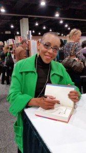 Here's author Andrea Davis Pinkney, the New York Times bestselling and award-winning author of many books for children and young adults, including picture books, novels, works of historical fiction and non-fiction. She's signing a copy of her new book The Red Pencil for our class.